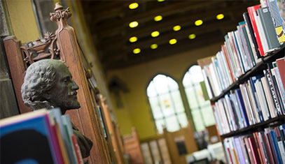 Image of a bust of Shakespeare in a library.