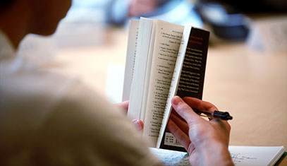 Image of someone holding a book.