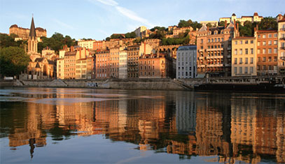 Image of the city of Lyon. The image shows buildings along a river.