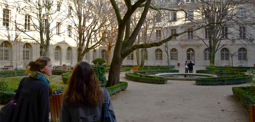 Image of students standing in a campus courtyard.