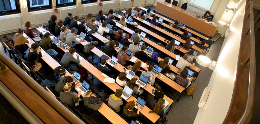 Image of a lecture hall filled with students.
